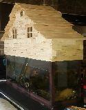 تولید انواع کلبه آکواریوم با چوب طبیعی